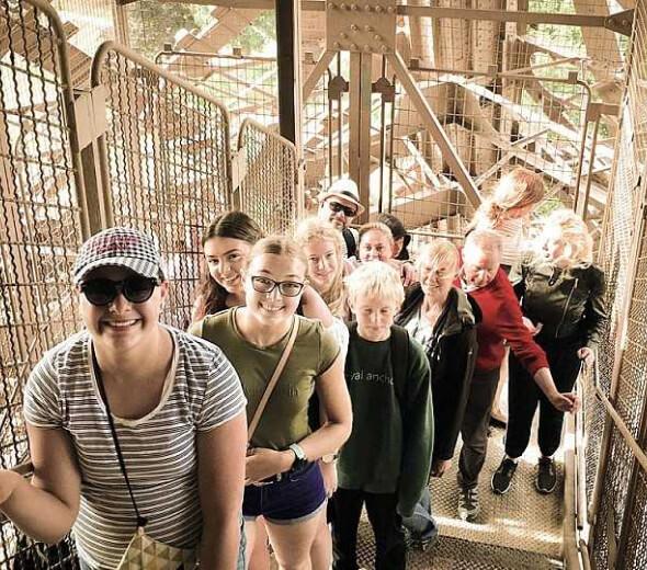 tour group climbing eiffel