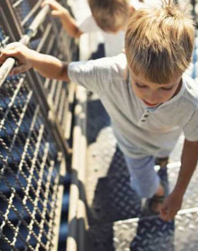 boy climbing the Eiffel Tower
