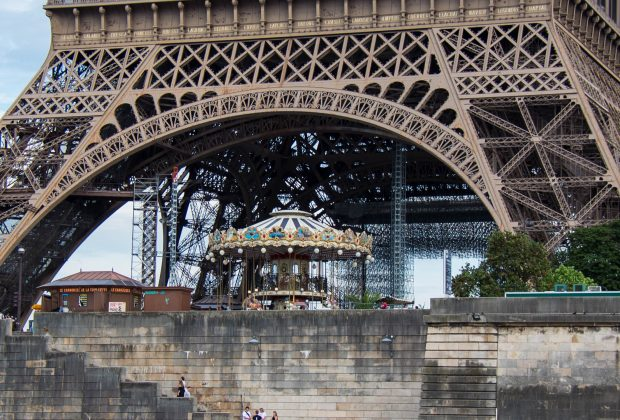 Eiffel Tower with Parisians on the river bank