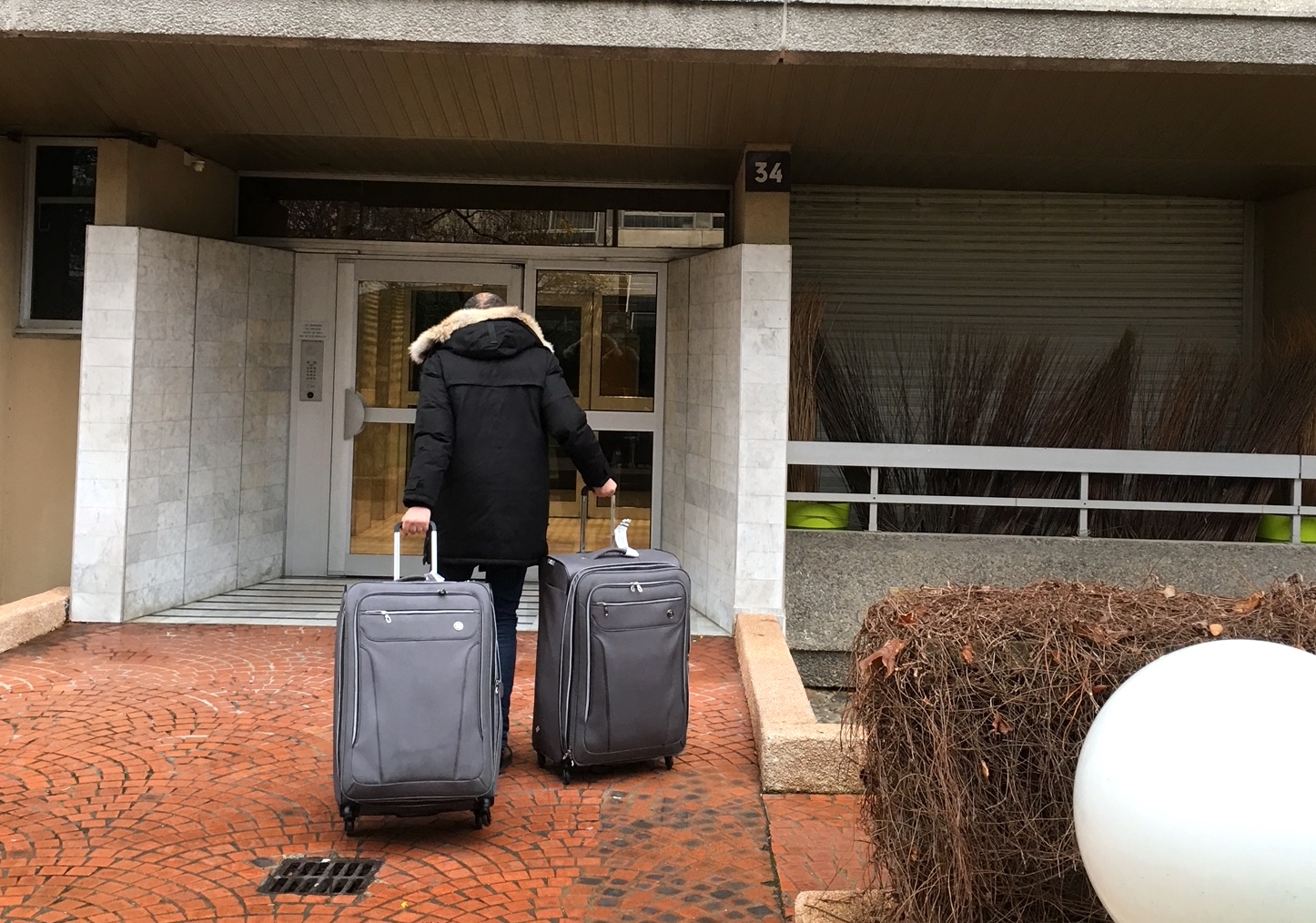 A cab driver in Paris pulling Linda's two suitcases to her new apartment