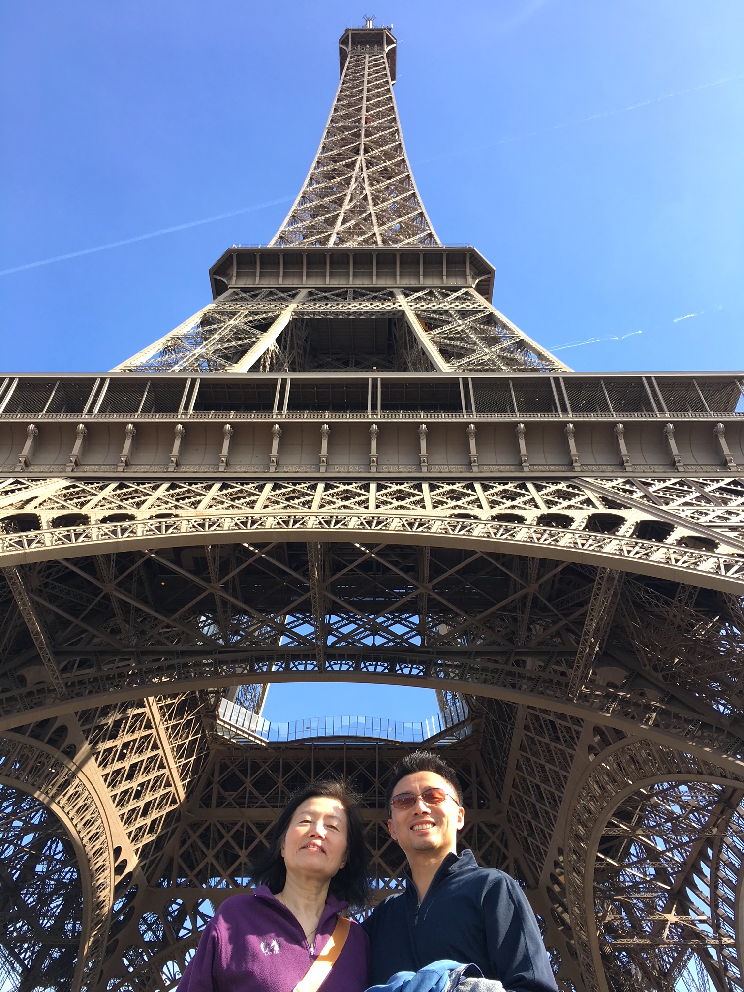 Andrew and his mom under the Eiffel Tower before the first climb