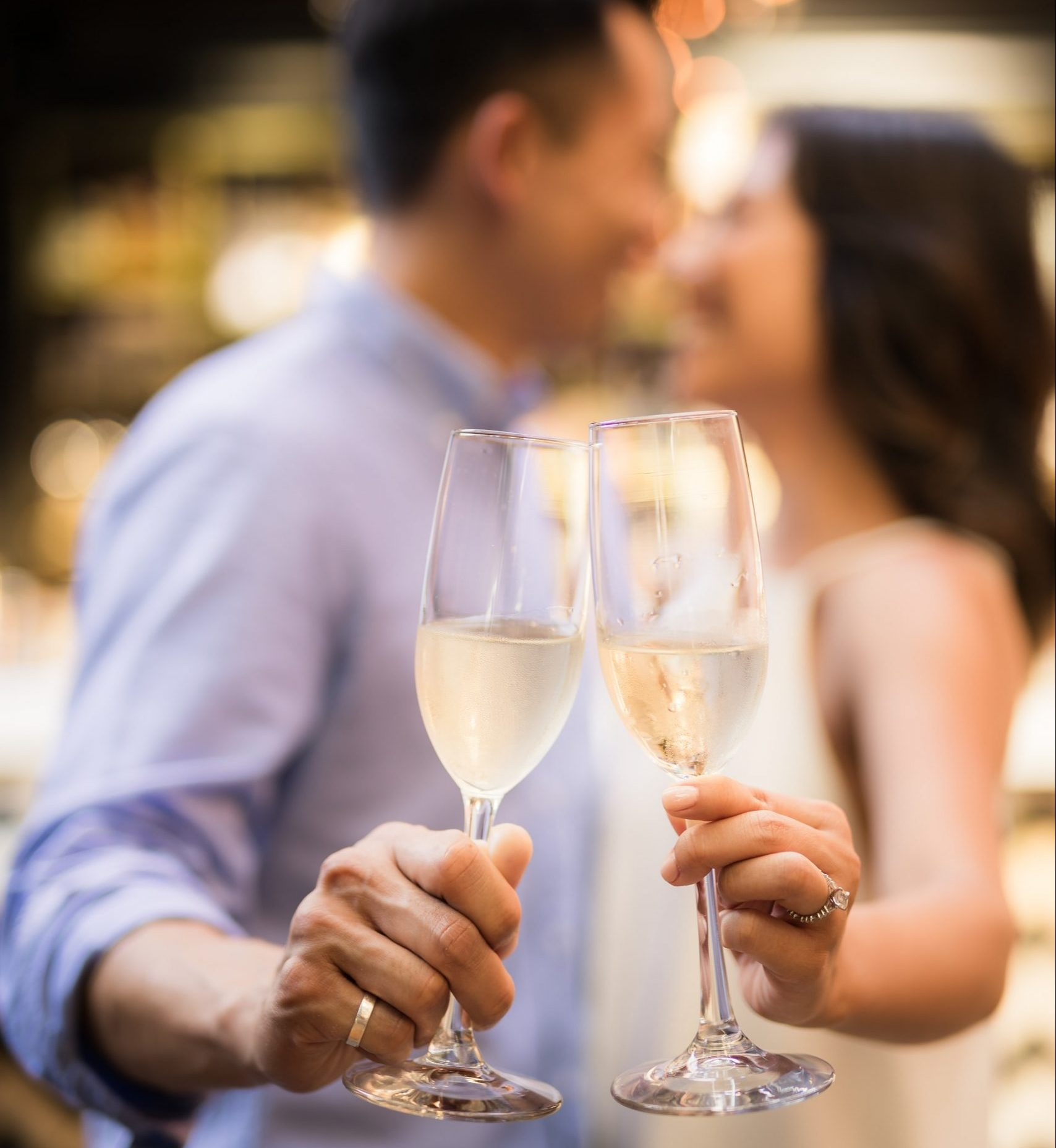 Couple in love holding champagne