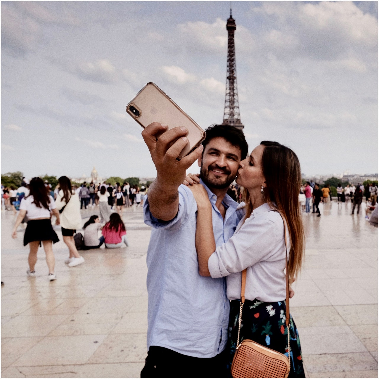 Couple taking a photo at the Eiffel Tower